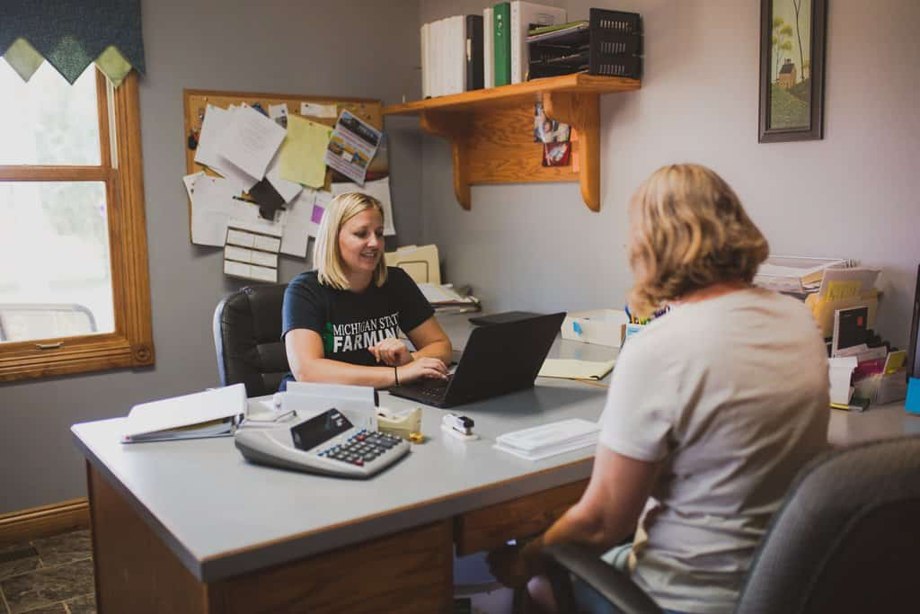 Debbie Gentner-Bischer and Rita Hereford work in their farm office