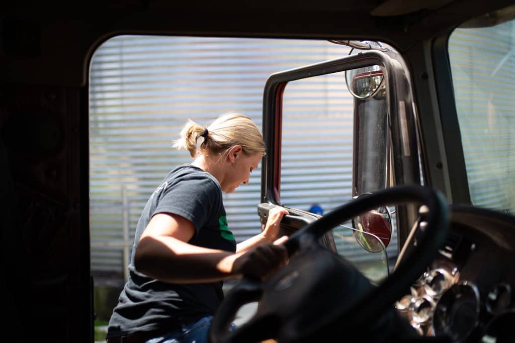 Farm woman getting in truck cab