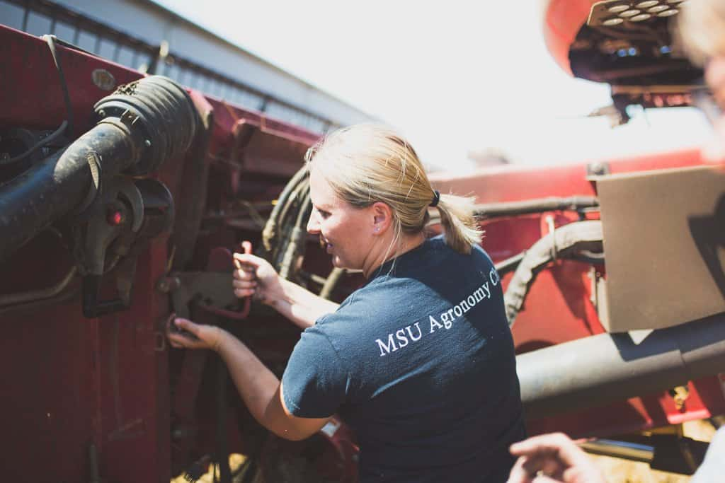 FarmHer in Michigan working on a tractor