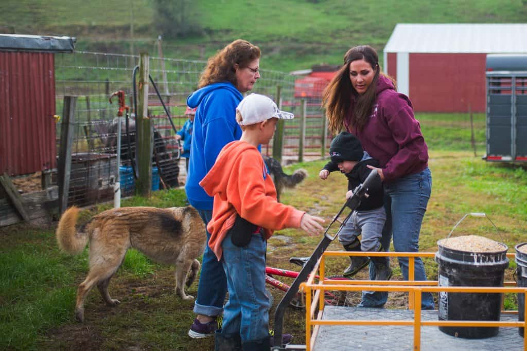 FarmHer Tammy Wiedenbeck and family load up farm kids to feed animals on the cattle ranch