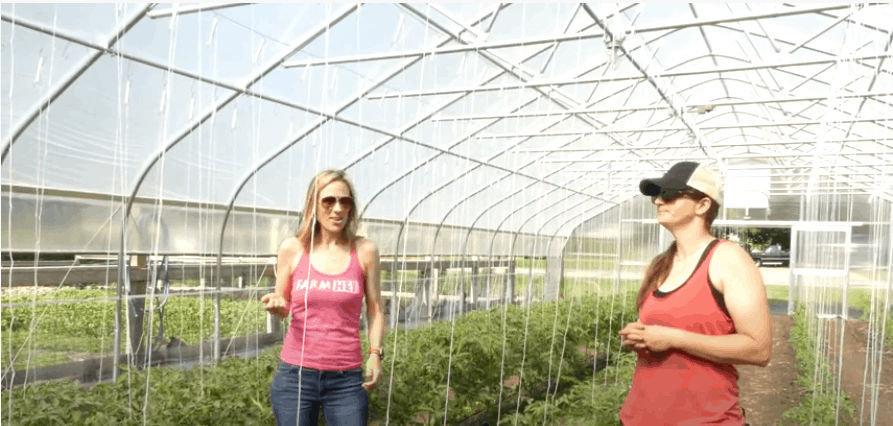 FarmHer Jenny Quiner and Marji Alaniz standing in a greenhouse