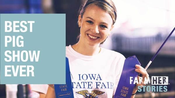 Lexi Marek at the Iowa State Fair pig show holding blue ribbons.