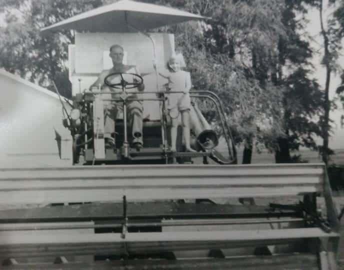 Vintage combine on MARJI GUYLER-ALANIZ's family farm
