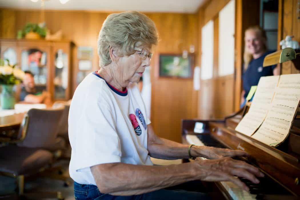 FarmWoman playing the piano in her living room