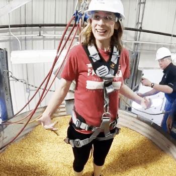 marji is waiting to sink into a grain bin full of corn