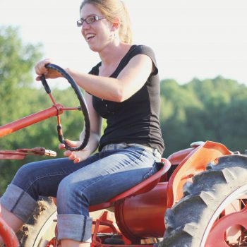 kate edwards of wild woods farm drives her tractor