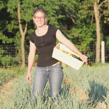Kate Edwards stands in a field at Wild Wood Farms in Iowa.