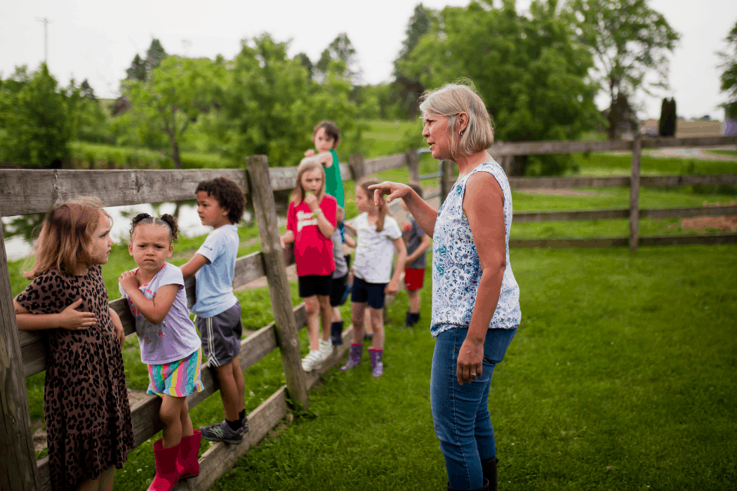 Heather Norman gives her students instructions for their day at Kinderfarm Preschool