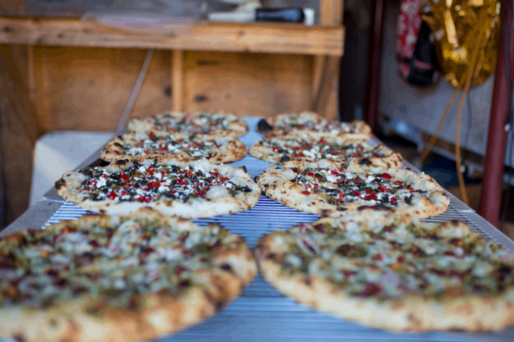 Farm fresh veggie pizza comes hot out of the oven in Vermont.