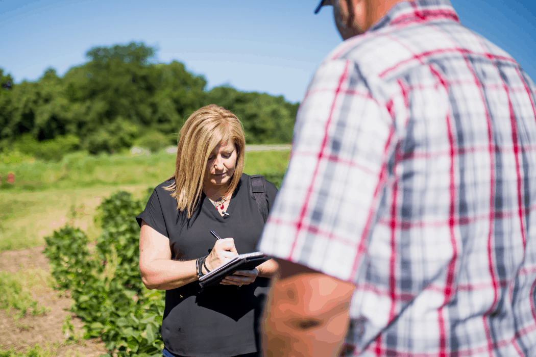 Holly Spangler interviews a local farmer for her job with Prairie Farmer magazine.