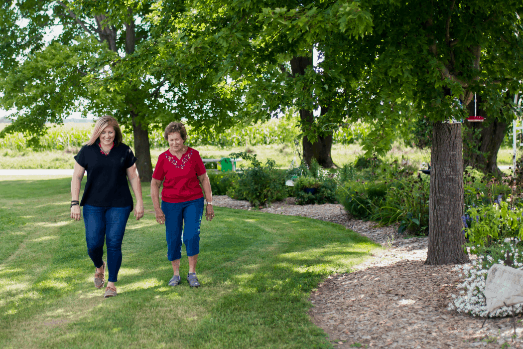 Holly walks with her mother-in-law on the family farm in Illinois.