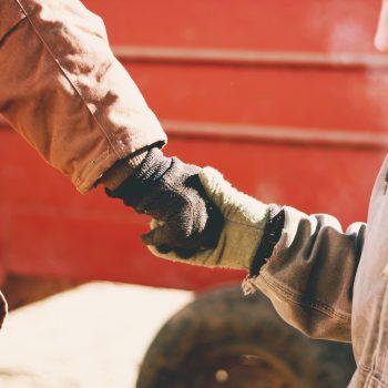 Farm Women Shaking Hands