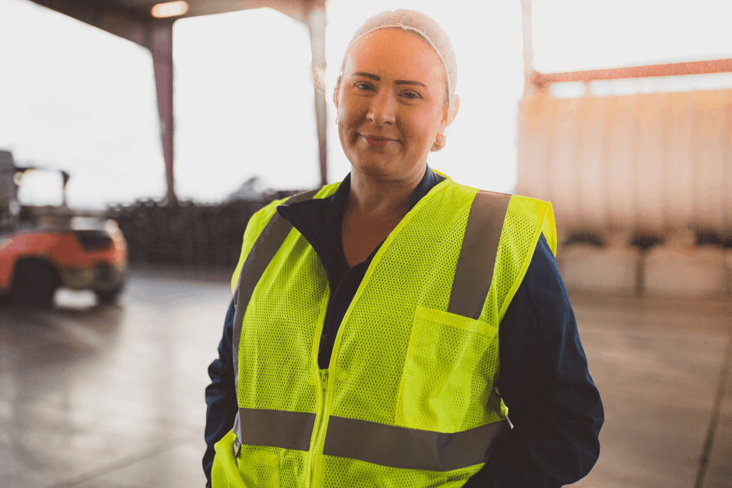 Stephanie stands in warehouse that she helps manage at Duncan Farms.
