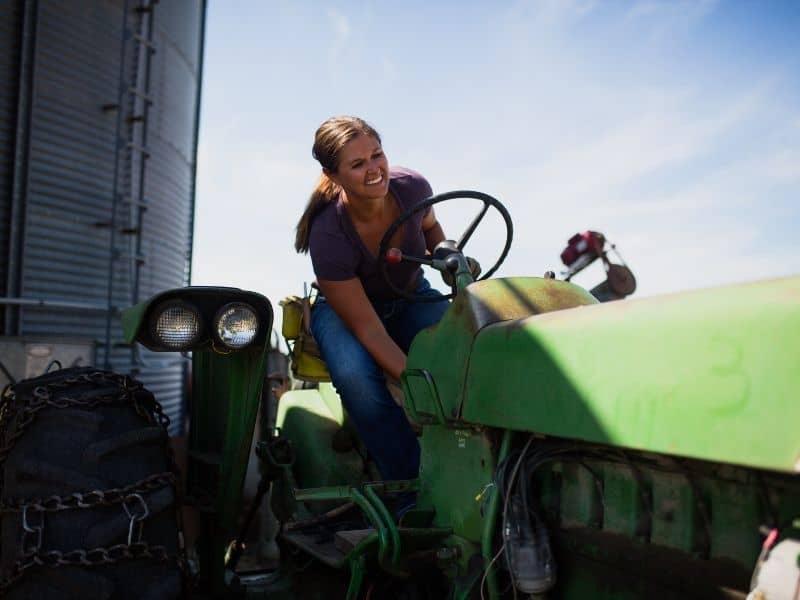 woman on john deere tractor