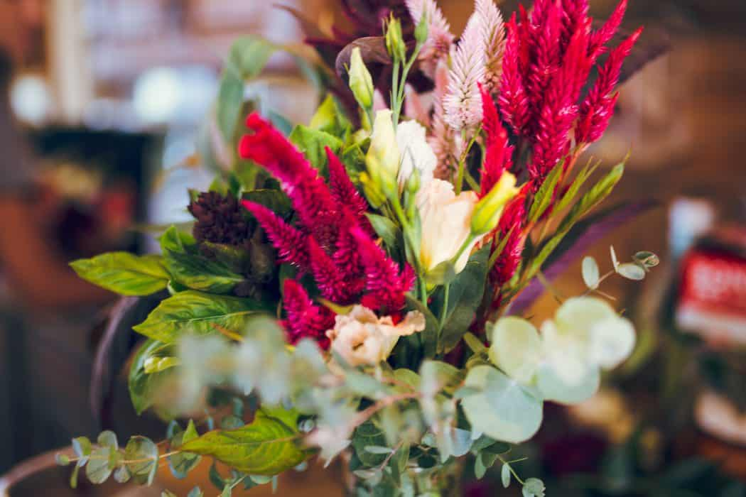 Fresh flower arrangement with pink flowers and greenery grown on a family farm.