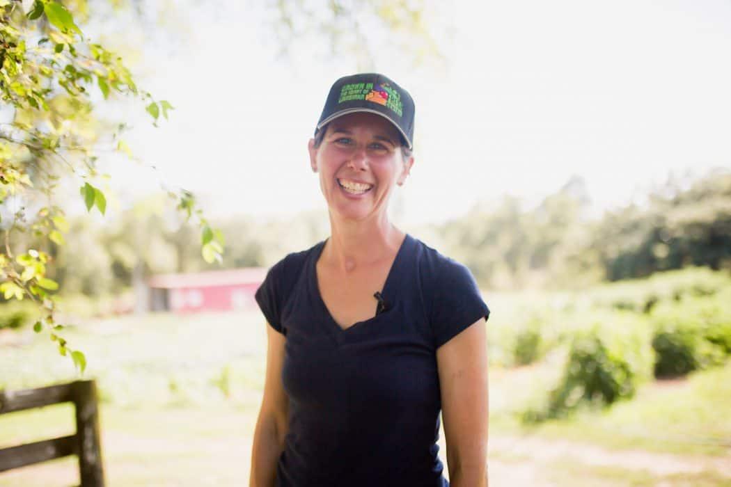 Danelle Myer standing in produce field.