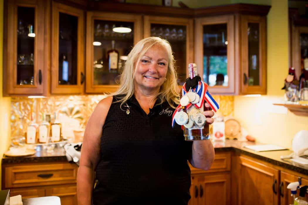 Liz Henry of J. Henry & Sons bourbon in her tasting room in Wisconsin.