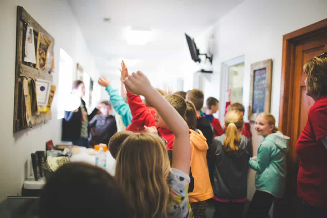 A field trip tour with children at the Marcoot Creamery.