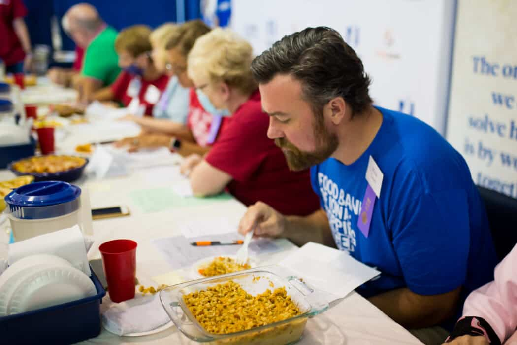 Judges tasting casseroles at the Food Bank of Iowa Chopped- Hot Dish Edition contest at the Iowa State Fair.