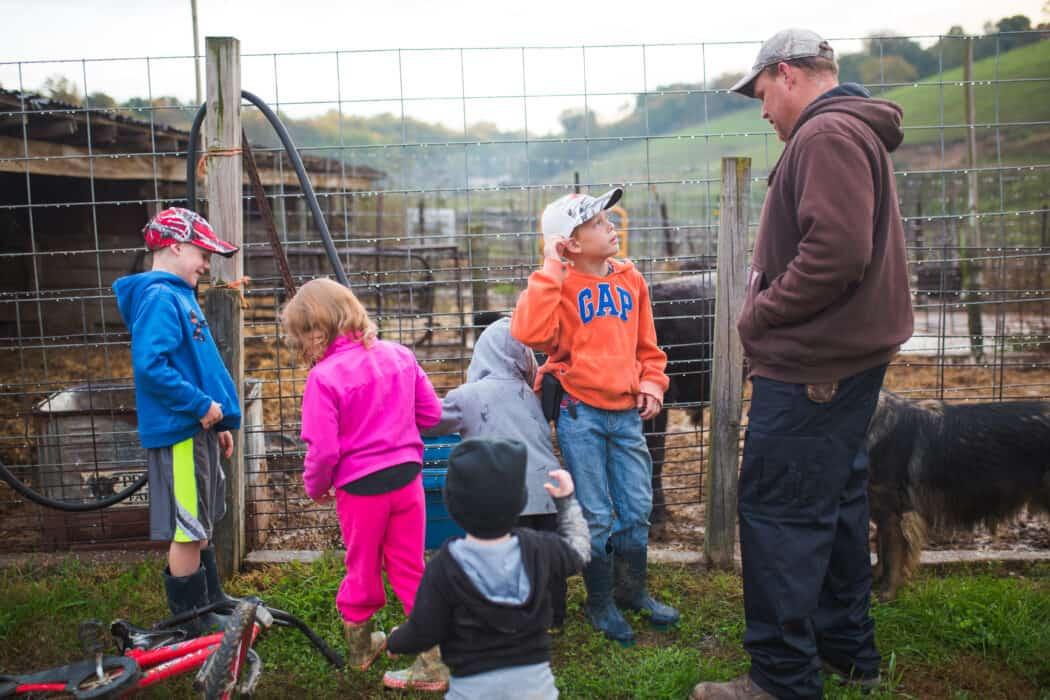 A farm family working together on their farm.